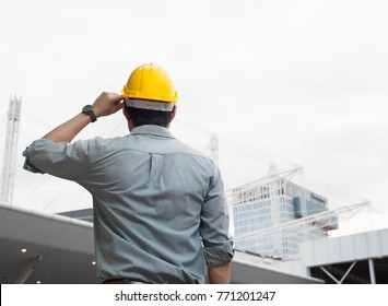 engineer,engineer man,engineer hat,Engineer is looking at the construction,smart engineer on day light background