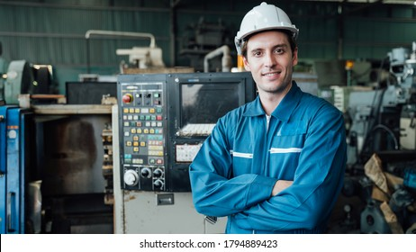 Engineer,Industry and construction concept. Portrait of caucasian Industry factory maintenance engineer wearing uniform and safety helmet in factory.