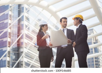 Engineering and architecture concept,engineers working on a building site holding a blueprints,architect man working  with engineer women inspection in workplace for architectural plan