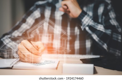 engineering and architecture drawings concept, Engineer man writing of architect starting draw a house blueprint on the desk in the home office, work from home