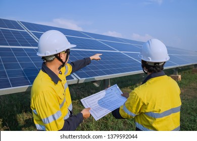 Engineering is checking the accuracy of the solar panel system installation, alternative electricity source, concept of sustainable resources.
