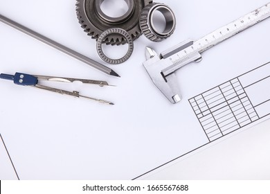 engineering concept. drafting accessories, drafting paper and metal gears with copy space