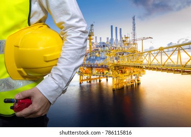 Engineering concept in office with Offshore oil and gas rig platform with beautiful sky in the gulf of Thailand.