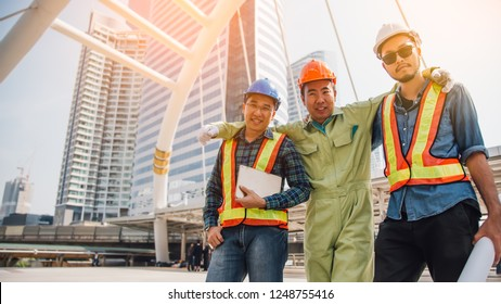 Engineering construction teamwork concept : professional engineer work city project site ,selective focus.Construction engineers discussion with architects at construction site or building.