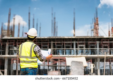 Safety plan images stock photos vectors shutterstock engineering consulting people on construction site holding blueprint in his hand building inspector construction malvernweather Images
