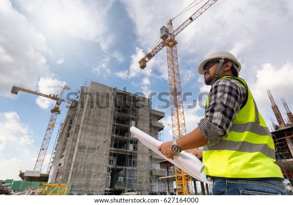 Engineering Consulting People On Construction Site Stock