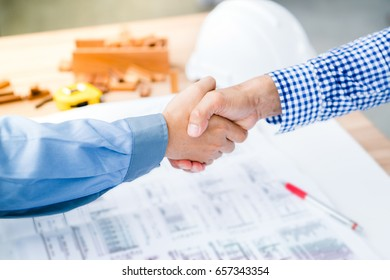 Engineering contract with the business owner. To design a successful plan. with blurred background of contractor use effect.