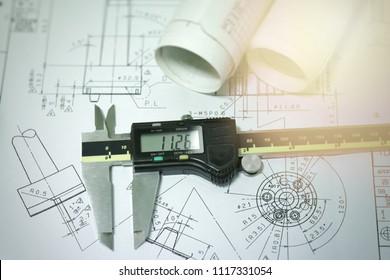 Engineering drawing and digital vernier calipers focus at digital scale of caliper