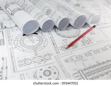 Engineering drawings on the table. The workflow design.