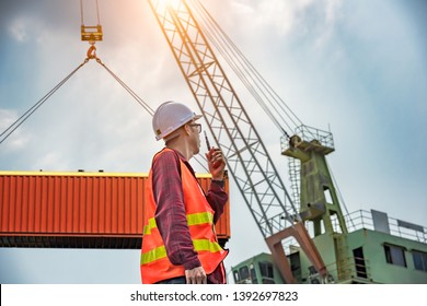 engineering, foreman, supervisor, worker, loading master in work site, control to the teamwork by walkie talkie radio for job done in the same direction, working at risk and high level of insurance
