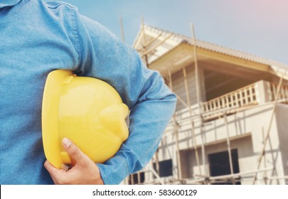 The engineering and a helmet for safety on construction of new home building