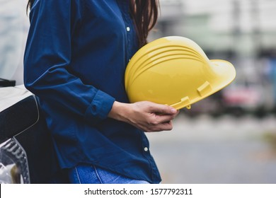 Engineering hold yellow hard hat safety work place outdoors background