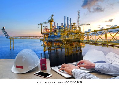 Engineering Industry concept in office with Offshore oil and gas rig platform with beautiful sky in the gulf of Thailand.