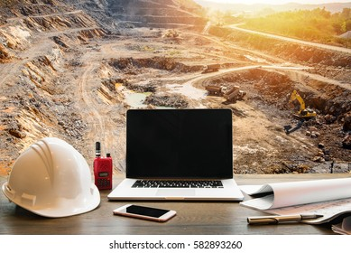 Engineering Industry concept, workspace of engineer on opencast mining quarry with lots of machinery at work This area has been mined for copper, silver, gold, and other minerals background