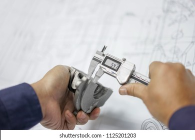 Engineering inspection check dimension automotive parts reference drawing by vernier caliper in industrial factory