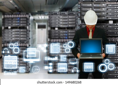 Engineering with laptop in data center room