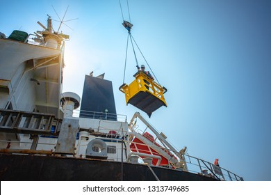 engineering, loading master, port manager in transferring basket, lifting by gantry crane, working at risk on the high level insurrant