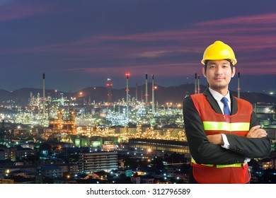engineering man and safety helmet, shirts standing arms crossed against oil refinery plant in petrochemical industry