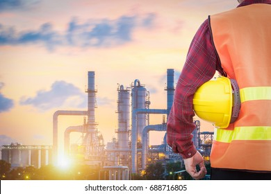 engineering man and safety helmet standing in the Petroleum industry