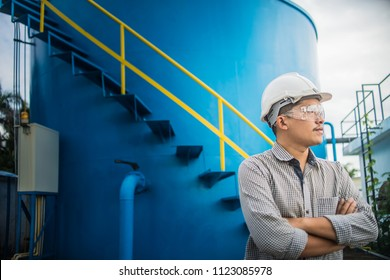 Engineering Man wearing white hard hat at Natural gas processing facility, oil and gas maintenance and service