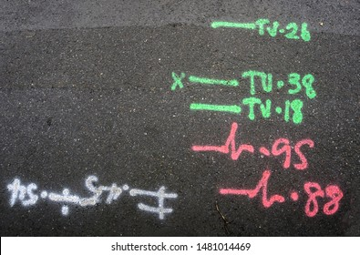Engineering markings on pavement surface indicating location of subsurface cables