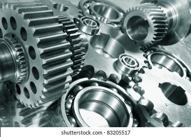 engineering parts arrangement, blue toning concept, focal-point on the large closest gear