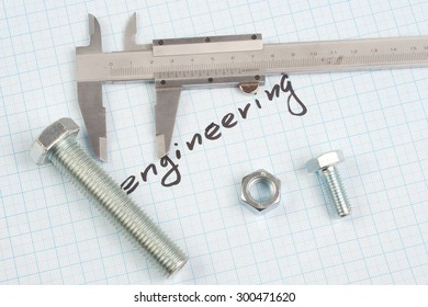 """engineering"" - Screw and  Nuts on  graph paper background"