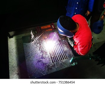 Engineering student perform arc welding