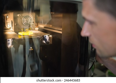 Engineering student using 3d printer at the university