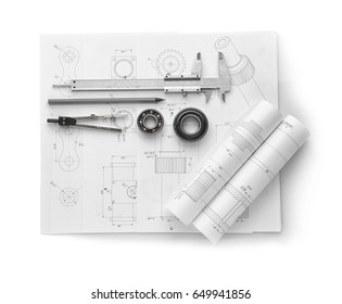 Engineering supplies and part blueprints on white background