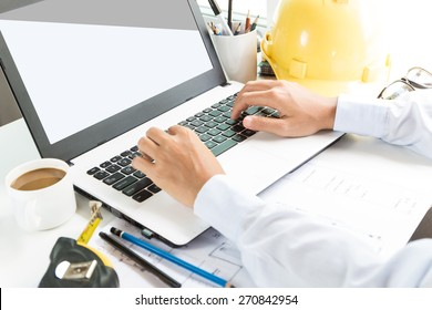 engineering use laptop computer on workspace