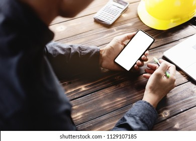 engineering using phone mobile on desk