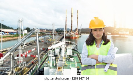 Engineering wearing yellow helmet and working at construction site about transportation of international logistics background