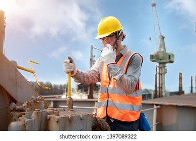 engineering or worker, loading master or controller working in communication by walkie talkie to the team for safety loading winch of the crane, lifting gears operation in industrial work site