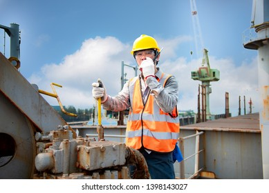 engineering or worker, motor man, loading master controller working in communication by walkie talkie to the team for safety loading winch of the crane, lifting gears operation in industrial work site