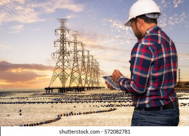 Engineering working hold tablet in front of oil refinery power station and Petroleum industry