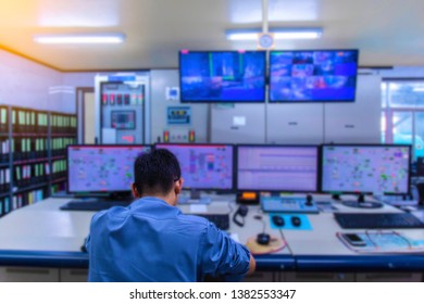 Engineering works with the tablet in the production control room.Control room of a steam Turbine,Generators of the coal-fired power plant for monitor process, business and industry concept