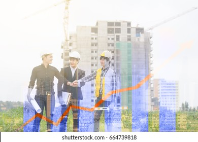 Engineers before hand to work construction.