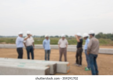 Engineers blurred out to check construction work so as to form.
