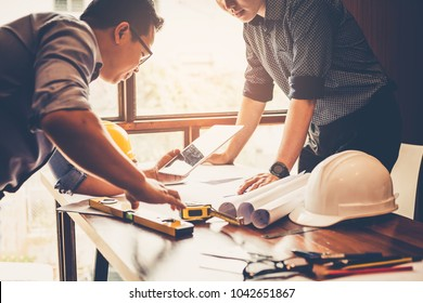 Engineers and businessmen are discussing construction projects in workplace. Construction concept.