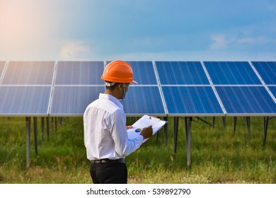 Engineers checking solar panels