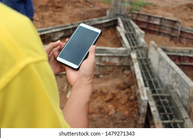 Engineers are checking work using mobile phones, taking blurred images