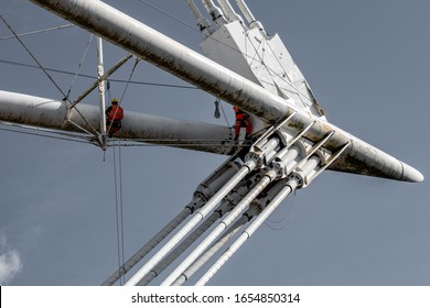 Engineers climb with cables in Cardiff  stadium