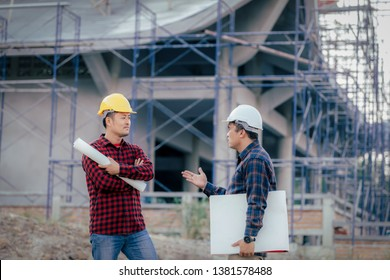 Engineers, construction sites, two businessmen Engineering objects in the workplace with architectural plans Draft construction project