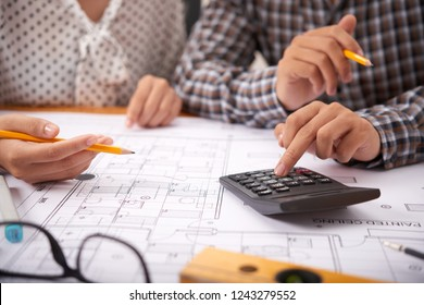 Engineers discussing cost of construction of house