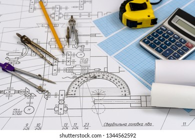 Engineer's drawing with tools and calculator close up