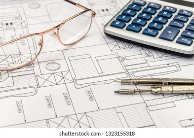 Engineer's esquisse with calculator, compass and spectacles