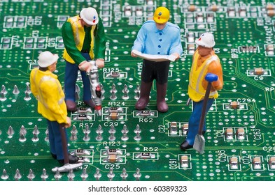 Engineers Fixing Computer Circuit Board