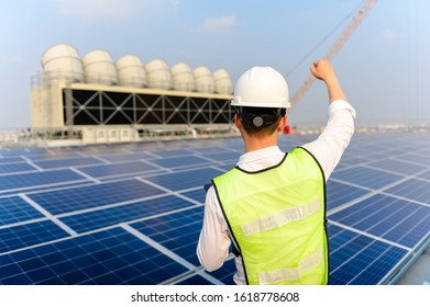Engineers have successfully installed solar cells to save energy in the building. Using solar cells is energy saving. Renewable energy concepts.