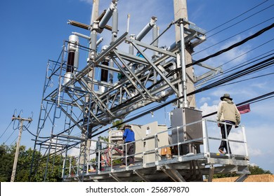 Engineers are installing circuit switcher,the protection system of high voltage.